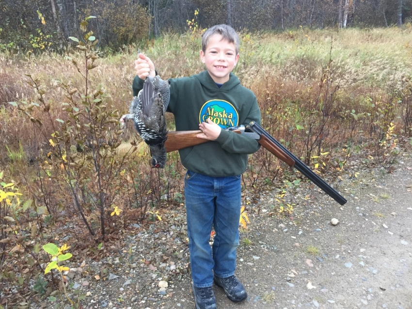 Jared's first bird: grouse taken on the wing in Grayling