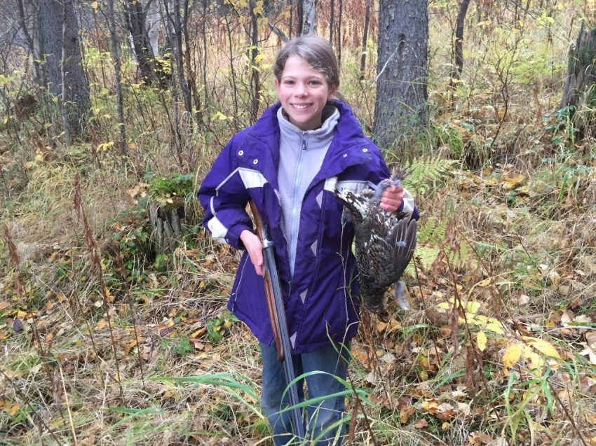 Christa's first bird: grouse taken on the wing in Grayling