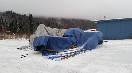 Freezing rain/sleet/snow covered the in the season's first snowfall last week. James and half a dozen men for as many hours employed creative methods to de-ice the plane, then covered it with tarps.