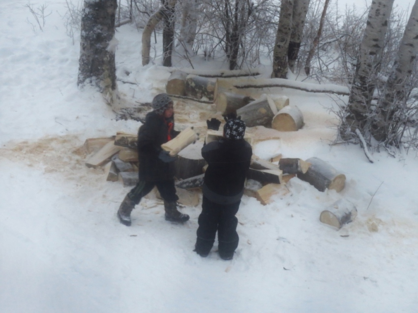 Some of the boys helped Jared move the wood into the basement
