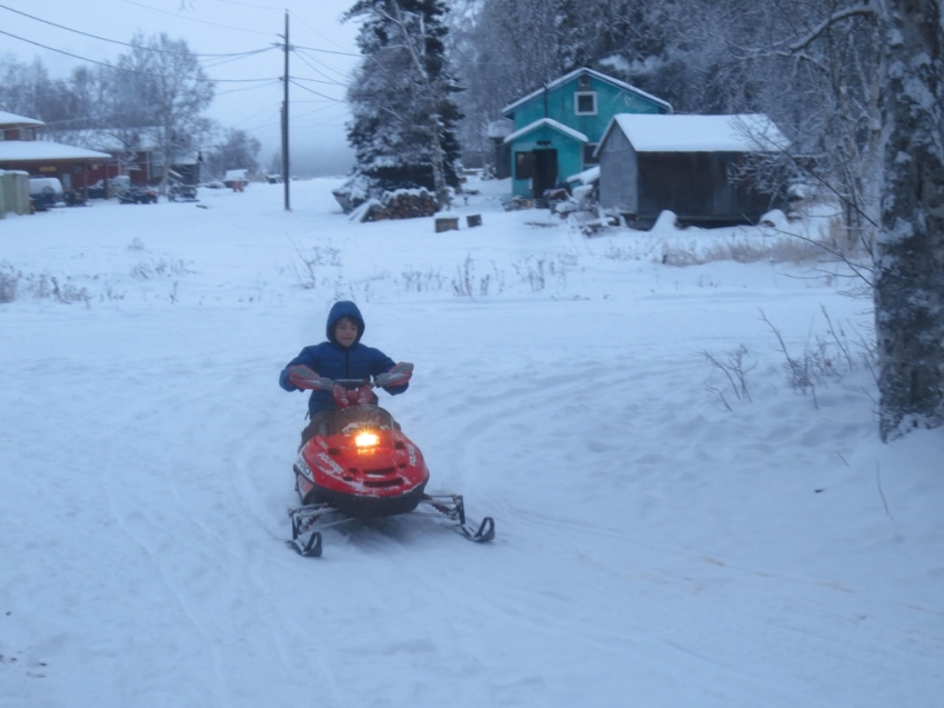 Another friend brought by his new kid-sized snow machine; Jared had a great time trying it out.